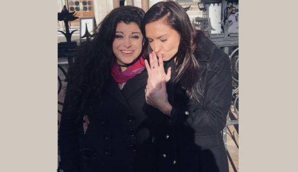 Photo of Chrissy proposing to her partner Bria on the pavement after the verdict.