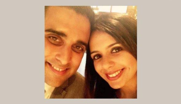 Selfie photo of smiling couple.