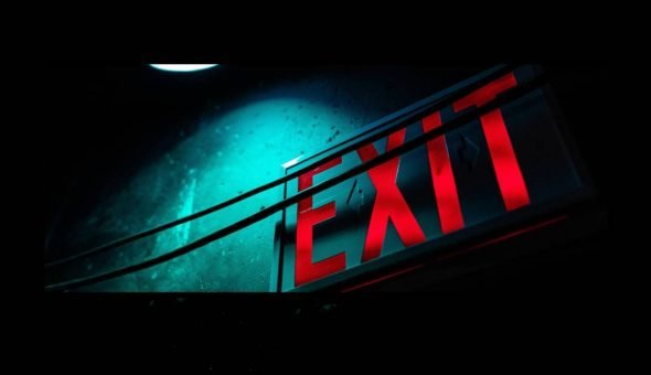 Photo of a lit up Exit sign.