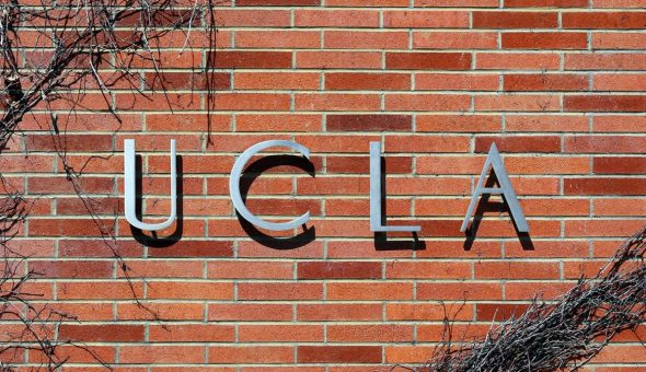 """An entrance to the University of California, Los Angeles. Sign reads """"UCLA""""."""