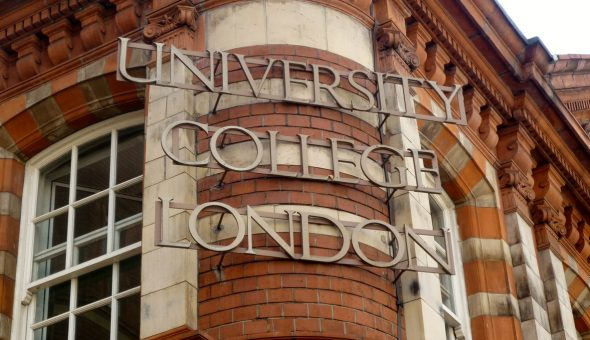 The sign for University College London (UCL) on the exterior of the Cruciform Building on Gower Street.