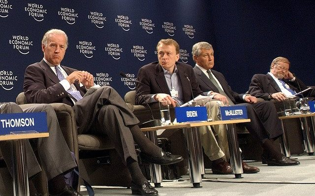 Photo of Dr McAllister chairing a panel at the World Economic Forum 2003, with future US President Biden.