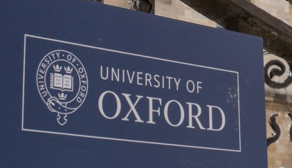 Photo of logo and part of the campus of Oxford University.