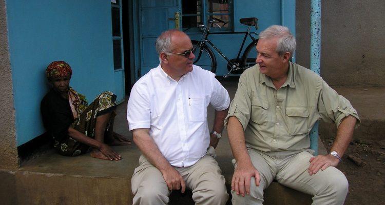 photo of Phil Davis sitting with presenter Jon Snow.