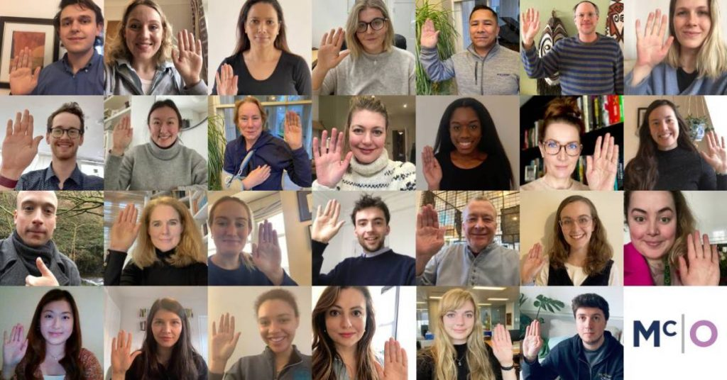 Collaged photo of McAllister Olivarius people with their hands up for International Women's Day 2021.