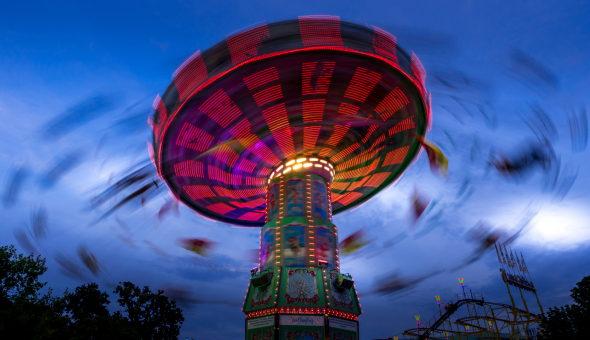 Photo of spinning fair ground ride.